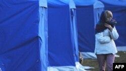 یک زن ایتالیایی که خانه اش را در زلزله روز دوشنبه از دست داده است.