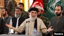 Gulbuddin Hekmatyar speaks to supporters the eastern Afghan city of Jalalabad on April 30.