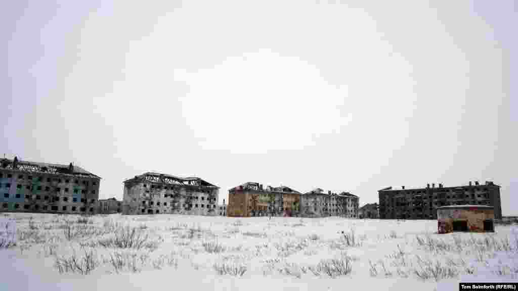 Abandoned buildings in Vorkuta city, near the Vorkuta River