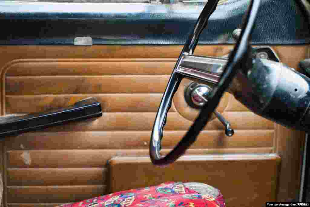 The interior of an old, Soviet-era Volga. Twenty-five years ago, owning a Volga was a matter of immense pride. Now they're considered shabby and second-rate, with most Turkmen preferring foreign-made cars.
