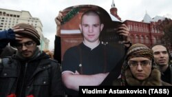 Members of anti-fascist movements hold a poster depicting Antifa group leader Ivan Khutorskoy during a meeting in his memory near the Kremlin in Moscow. (file photo)