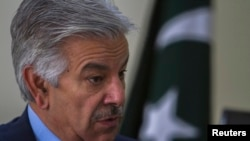 Defense Minister Khawaja Asif speaks during an interview with Reuters at his office in Islamabad, March 6, 2014