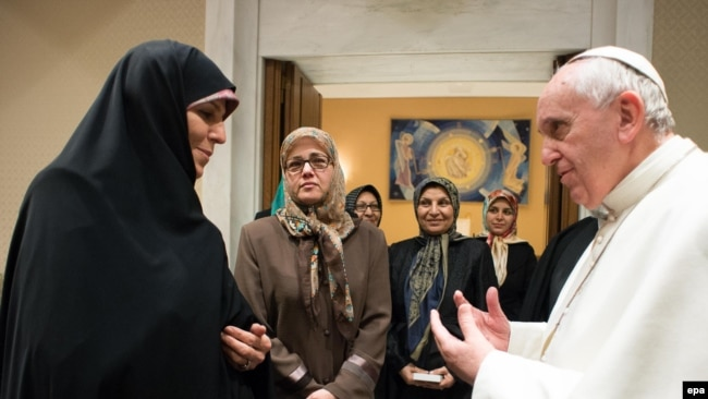 Pope Francis receives Iranian Vice President Shahindokht Molaverdi (L), in Vatican City, February 12, 2015