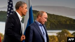 U.S. President Barack Obama (left) and Russian President Vladimir Putin during the G8 summit at the Lough Erne resort near Enniskillen in Northern Ireland on June 17.