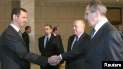 Syria -- President Bashar al-Assad (L), welcomes Russian Foreign Minister Sergei Lavrov to Damascus, 07Feb2012