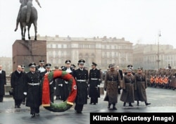 An image colorized by Olga Shirnina that was finished on May 26. The photo shows a wreath-laying ceremony in Warsaw in 1939, several months before Nazi Germany invaded Poland. This is one of three images Shirnina says would almost certainly result in a suspension of her account if she were to post it to Facebook.