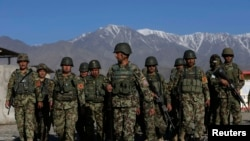 FILE: Afghan National Army (ANA) soldiers prepare to leave their base for a patrol near Kabul.