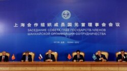 A signing ceremony during the Shanghai Cooperation Organization summit in the Great Hall of the People in Beijing on June 7, when the two-day gathering was concluding.