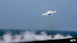 An F-18 Super Hornet takes off from the flight deck of the USS Dwight D. Eisenhower in October 2016 in the Persian Gulf. The Pentagon confirmed that a Syrian fighter bomber was downed by a U.S. F-18 Super Hornet on June 18.