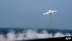 A F/A-18E Super Hornet takes off from the flight deck of the aircraft carrier USS Dwight D. Eisenhower on October 20, 2016 in the Gulf, October 21, 2016