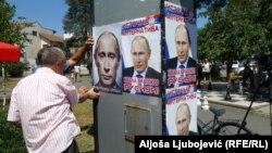 Lijepljenje postera sa Putinovim likom
