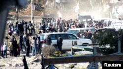 Жители Хомса во время эвакуации, 9 февраля 2014 г.