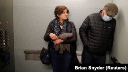 Maziar Hashemi (right), who has the cancer Myelodysplastic syndrome, and his wife, Fereshteh, leave in an elevator after meeting with his transplant doctor at a hospital in Boston, Massachusetts, on March 26.