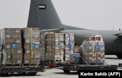 Tons of medical equipment and coronavirus testing kits provided by the World Health Organization being prepared for delivery to Iran with a U.A.E. military transport plane in Dubai in March