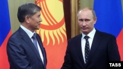 Russian Prime Minister and President-elect Vladimir Putin (right) with Kyrgyz President Almazbek Atambaev (file photo)