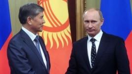 Russian Prime Minister and President-elect Vladimir Putin (right) with Kyrgyz President Almazbek Atambaev (file photo)