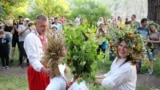 People dance in a circle during a celebration of Ivan Kupala Night in Khortytsya on June 21.