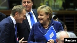 Polish Prime Minister Donald Tusk, British Prime Minister David Cameron, German Chancellor Angela Merkel, and EC President Herman Van Rompuy (left to right) will meet at the European Union summit in Brussels.