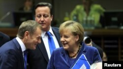Polish Prime Minister Donald Tusk, British Prime Minister David Cameron, and German Chancellor Angela Merkel (left to right) talk at an EU summit in Brussels in late October.