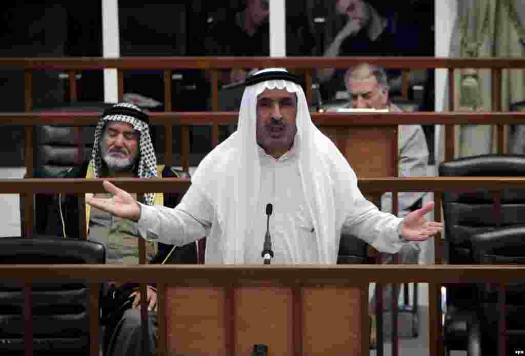 Mizhar Abdallah al-Ruwayid addresses the court on July 11 (epa) - Former local Ba'ath Party official Mizhar Abdallah al-Ruwayid was sentenced to 15 years' imprisonment.