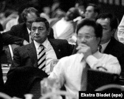 Gafur Rakhimov (left) attends a sports congress in Ankara in 1998