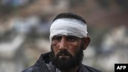 Этот снимок сделан 16 декабря в районе сирийско-турецкой границы. Один из жителей Алеппо, которому удалось эвакуироваться