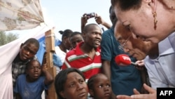 UN Secretary-General Ban Ki-moon speaks with displaced Haitians in front of the Haitian National Palace in Port-au-Prince on January 17.