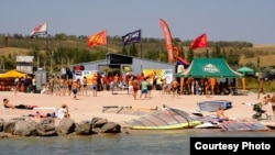 Anton Yevsyushkin boasts of the attractions of Mariupol, such as this windsurfing center.