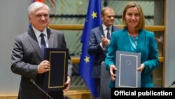 Belgium - EU foreign policy chief Federica Mogherini and Armenian Foreign Minister Edward Nalbandian sign the Armenia-EU Comprehensive and Enhanced Partnership Agreement in Brussels, 24Nov2017.