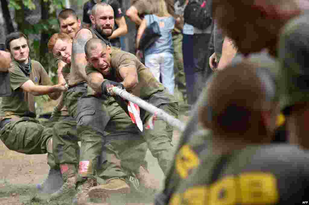 Recruits of the controversial far-right Azov volunteer battalion take part in a competition in Kyiv prior to leaving to the battlefields of eastern Ukraine. (AFP/Sergei Supinsky)