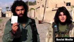 A photo of what pro-Islamic State social media claim is a member (left) of a predominantly Chechen IS faction in Syria and Iraq.