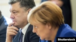 Ukrainian President Petro Poroshenko and German Chancellor Angela Merkel in Paris in October.