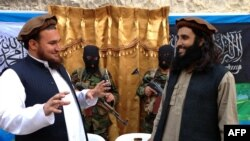FILE: Former Tehreek-e-Taliban Pakistan (TTP) spokesman Ehsanullah Ehsan (L) talks with new TTP member Adnan Rasheed