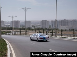A limo glides back towards central Ashgabat after a marriage ceremony at the palace.