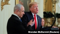 U.S. President Donald Trump (right) and Israeli Prime Minister Benjamin Netanyahu hold a joint news conference to discuss a new Middle East peace-plan proposal in the White House in Washington on January 28.