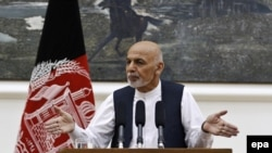 Afghan President Ashraf Ghani speaks to the audience during the Afghan Urban Development Conference, at the Presidential Palace in Kabul on September 21.