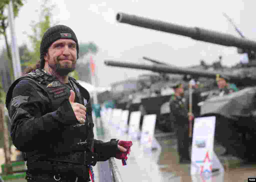 Night Wolves motorcycle club leader Aleksandr Zaldostanov gestures as he attends the Army-2015 International Military-Technical Forum in Kubinka, outside Moscow, on June 16. (TASS/Mikhail Pochuyev)