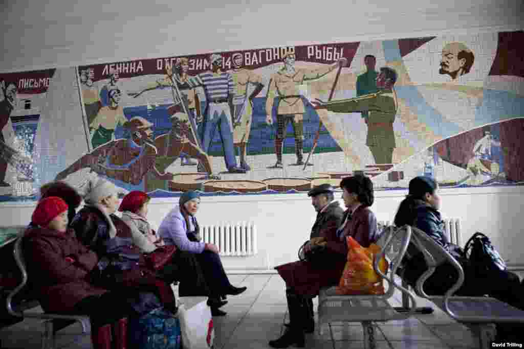 A mural in praise of local fishermen and their revolutionary zeal, at Aralsk railway station, Kazakhstan.