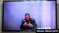 Jailed Kremlin critic Aleksei Navalny appears via a video link from prison during a court hearing on May 26.