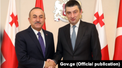 თურქეთის საგარეო საქმეთა მინისტრი მევლუთ ჩავოშოღლუ და საქართველოს პრემიერ-მინისტრი გიორგი გახარია