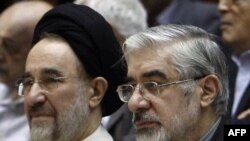 Hard-liners are calling for the arrest of opposition leader Mir Hossein Musavi (right) and his ally former President Mohammad Khatami.