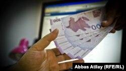 Azerbaijan - money, manat, corruption, bribe