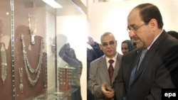 Iraq -- Prime Minister Nuri al-Maliki inspects antiquities during the re-opening ceremony of Iraq's National Museum in Baghdad, 23Feb2009
