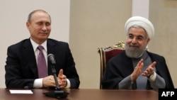 V.Putin və H.Rouhani