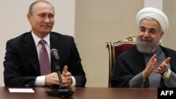 """Putin və Ruhani ABŞ-ın Suriyadakı """"təcavüzünü"""" pisləyiblər"""