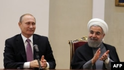 حسن روحانی، رئیسجمهور ایران (راست) و ولادیمیر پوتین، رئیسجمهوری روسیه