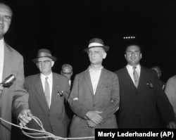 Rudolf Abel (center) is accompanied by U.S. marshals at Newark Airport on August 8, 1957.