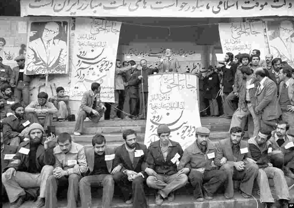 Heavily guarded by security, Mehdi Bazargan makes a speech at Tehran University on February 9, 1979. Bazargan was Ayatollah Ruhollah Khomeini's choice to take over Iran's government. Bazargan declared he would introduce Allah to all phases of Iranian life, revamp the economy, and hold free elections before resigning to make way for an Islamic regime.