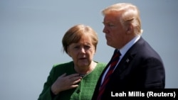 German Chancellor Angela Merkel talks with U.S. President Donald Trump at the G7 summit last month.
