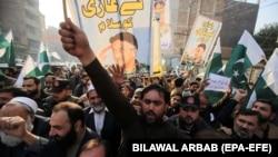 People shout slogans during a protest against the sentencing to death of former President Pervez Musharraf in Peshawar on December 24.